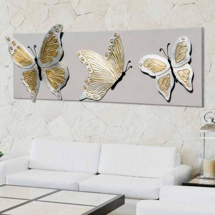 Modern beeld met drie in reliëf gemaakte vlinders die door hand Stephen worden verfraaid