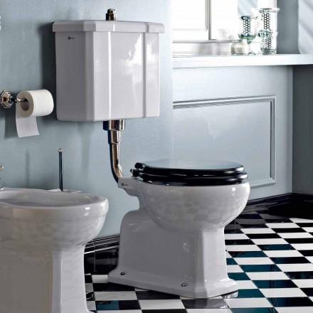 Op de vloer gemonteerd toilet met keramische cassette en zwarte stoel in Italië - Marwa